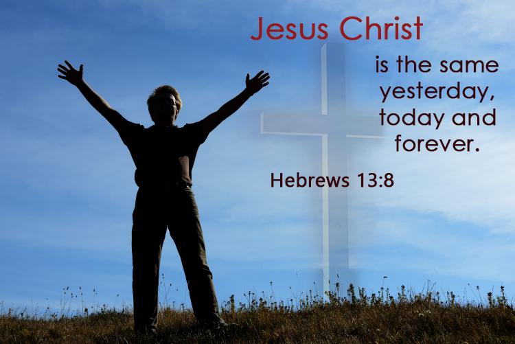 man standing beside the cross