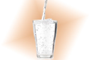 Glass full and being filled with water