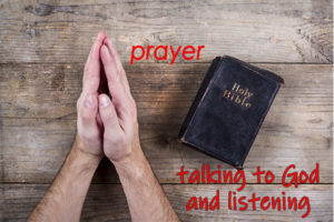"hands in prayer; holy bible; text ""Prayer - talking to God and listening"
