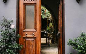 double wood door with one side open - open the door to Jesus